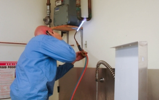 plumber brazing copper tube